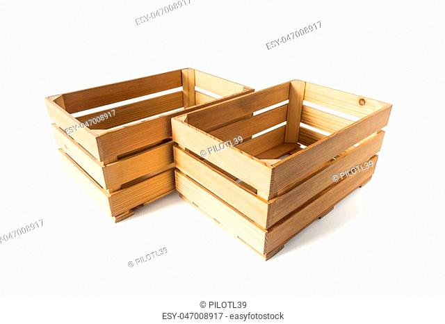 Two empty wooden boxes of smooth planks, isolated on white background