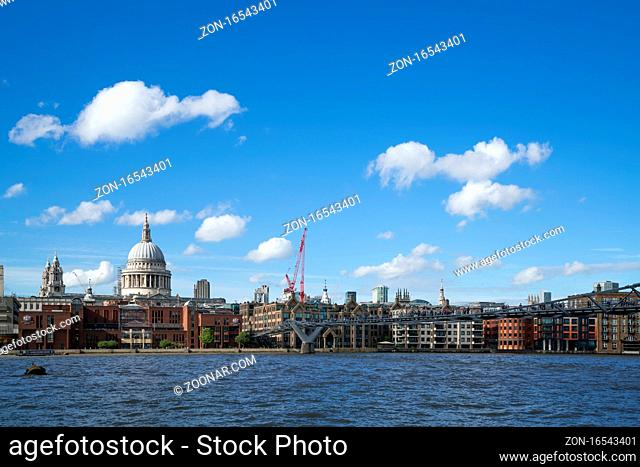 LONDON - JULY 27 : Buildings on the North Bank of the River Thames in London on July 27, 2017