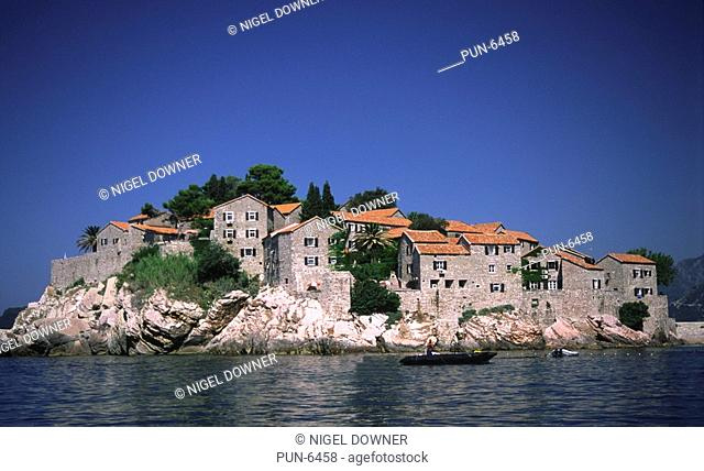 Scenic view of Sveti Stefan seen from the sea Situated on the Adriatic coast, it was a little fishing village but now a busy holiday resort in Montenegro