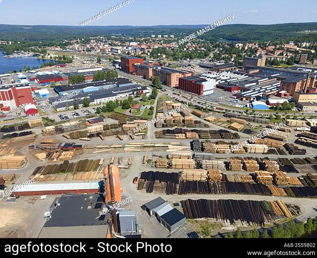 Rundvirke Poles and AB Impregna at Lyviken in Ludvika. Manufacture of impregnated wood and posts. Behind in the picture ABB Power Transformers
