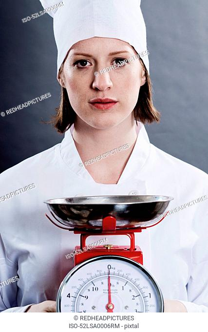 Chef holding kitchen scales