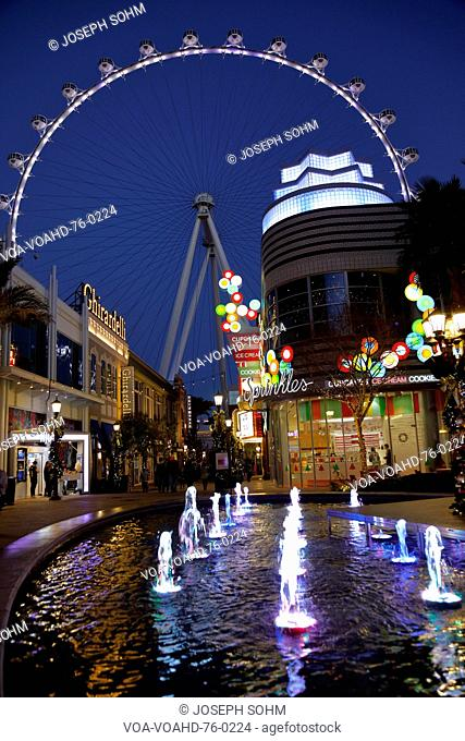Las Vegas, Nevada, USA - lighted water fountain in front of The High Roller Ferris Wheel at dusk off the Strip in Las Vegas, Nevada, USA