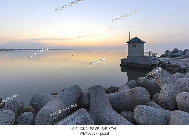 Europe, Italy, Veneto, Venice, Cavallino coast. Near the lighthouse of Punta Sabbioni at sunrise