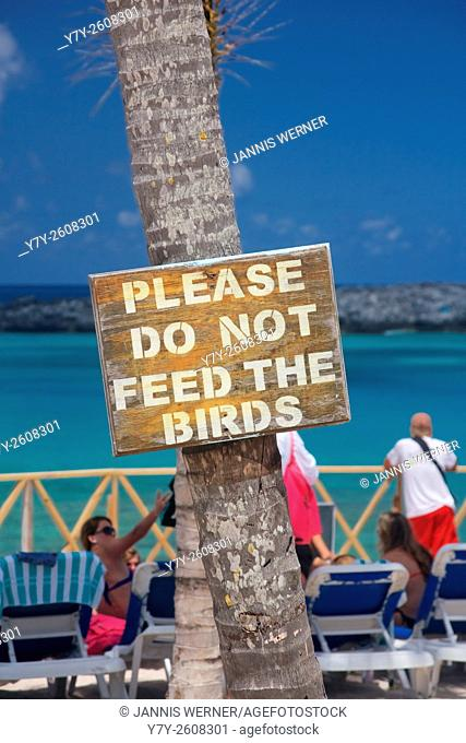 Sign on a tropical resort island asking Please Do Not Feed The Birds