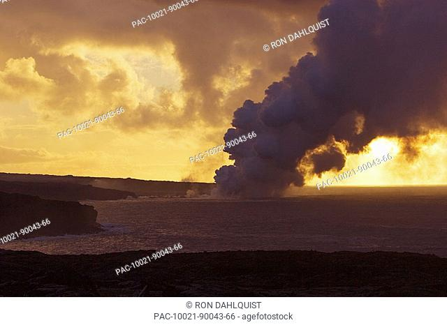 Hawaii, Big Island, Kalapana, Steam cloud from lava entering Pacific Ocean from Kilauea at sunset