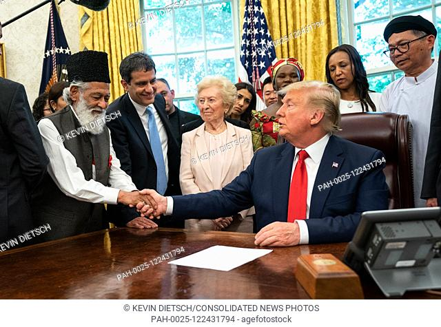United States President Donald J. Trump shakes hands with Abdul Shakoor, of Pakistan as he meets with survivors of religious perception in the Oval Office at...