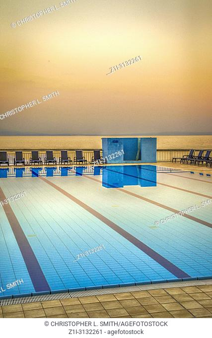 Empty public swimming pool at sunset on the waterfront at Opatija in Croatia