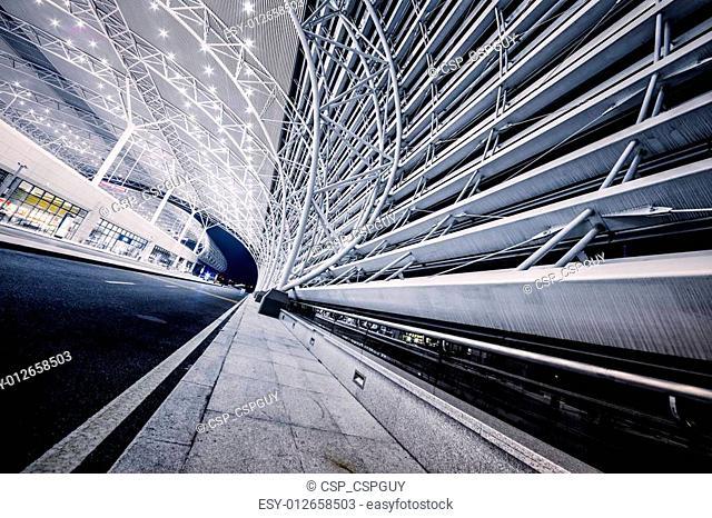 modern railway station in night