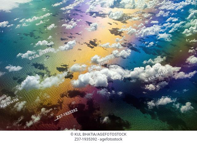 A symphony of color lights up a sunny sky somewhere over the Atlantic Ocean