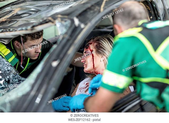 Paramedics helping car crash victim after accident