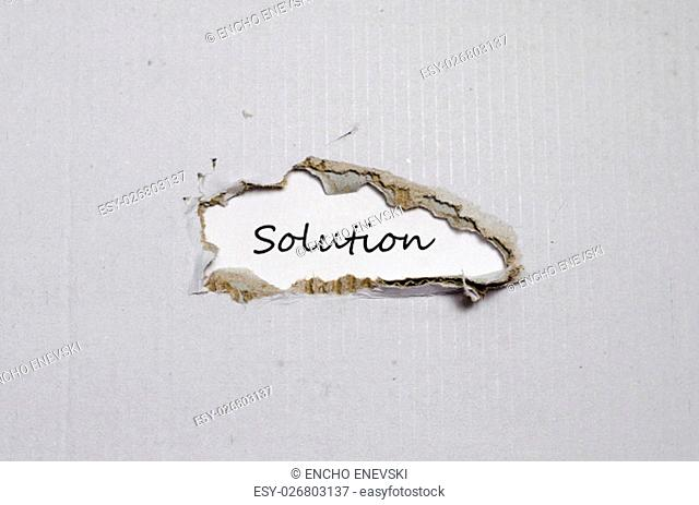 The word solution appearing behind torn paper