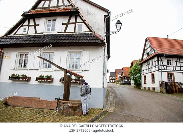 Traditional half-timbered houses in the streets of the small town of Hunspach in Alsace, on May 13, 2016 in France. Well and tourist