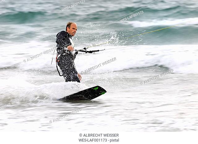 France, man kitesurfing
