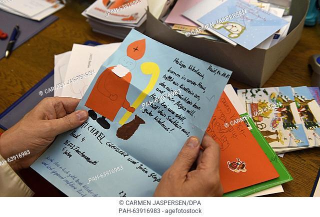 'Santa Claus' Hubert Wendehage reads a letter to Santa Claus in the Santa Claus office in Nikolausdorf (lit. Nicholas village), Germany, 24 November 2015
