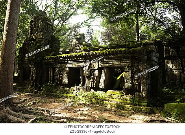 Ta Prohm, Angkor, Cambodia. Jungle temple with massive trees growing out of its walls. Tomb Raider shot here. 1186 CE