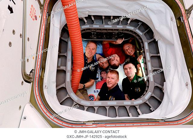 The six crew members of Expedition 47 pose for a picture from inside Orbital ATK's Cygnus vehicle. The resupply craft was named the S.S