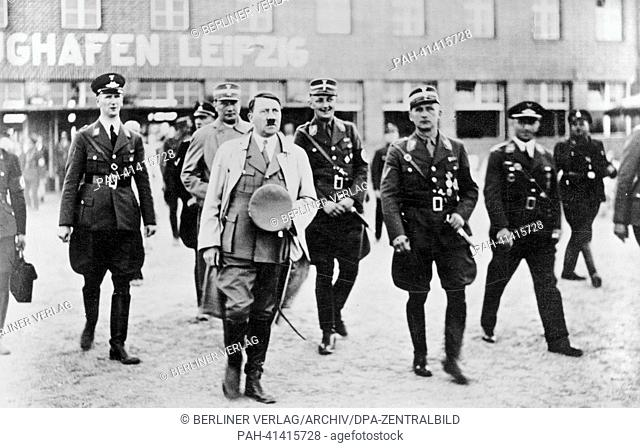 The image from the Nazi Propaganda! shows Adolf Hitler upon his arrival at the airport in Leipzig-Mockau, date unknown. (l-r): Airport manager Reinsberg