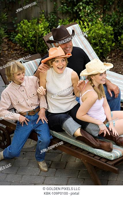 Family relaxing wearing country western clothing