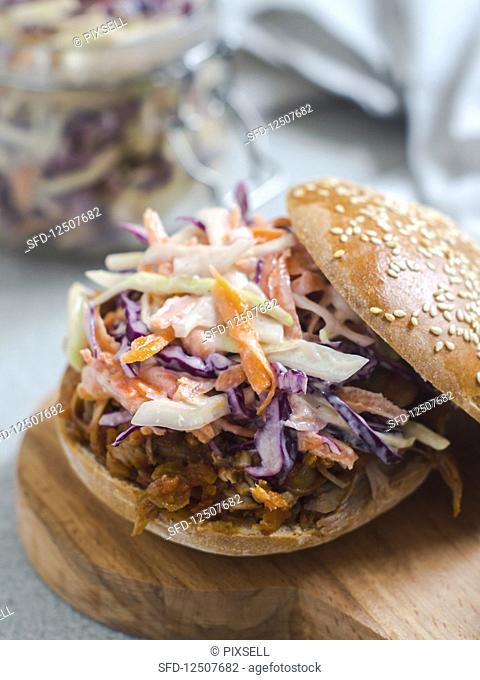 A pulled pork and coleslaw sandwich (USA)