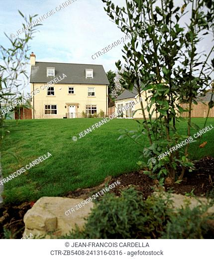 Rural detached property with a large front lawn