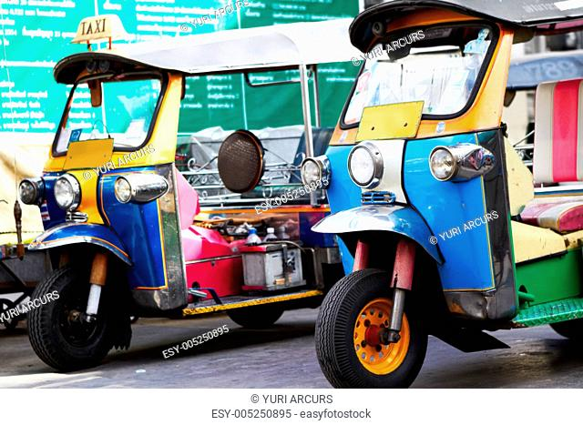Traditional Thai taxi parked in road - Tuk-Tuk