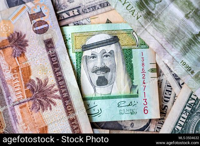 Saudia Arabia Riyal Placed Next To US Dollar And Chinese Yuan Closeup. Selective Focus