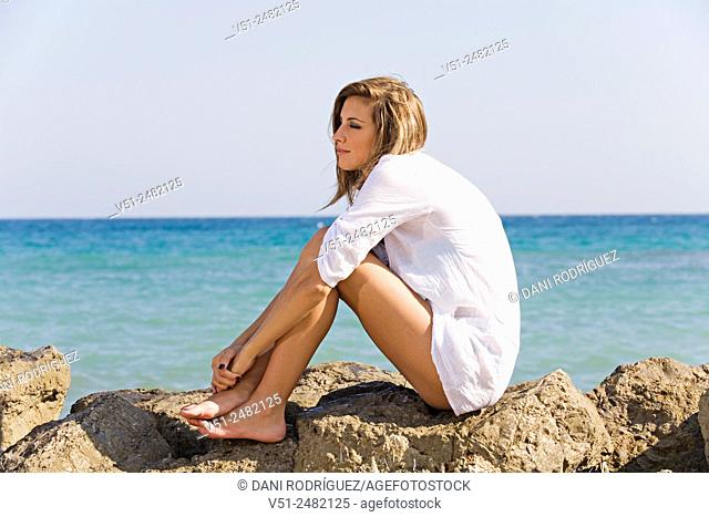 Woman relaxing by the sea
