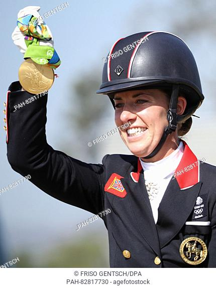 Gold medalist Charlotte Dujardin (Valegro) of Great Britain celebrates during the medal ceremony of the Dressage Individual Grand Prix Freestyle of the...