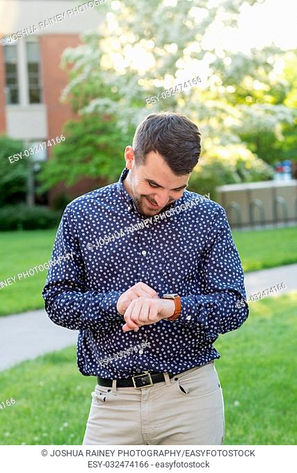 Male college senior outdoors for a natural light portrait on a university campus in Oregon
