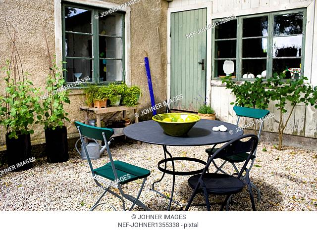 Chairs and table on patio
