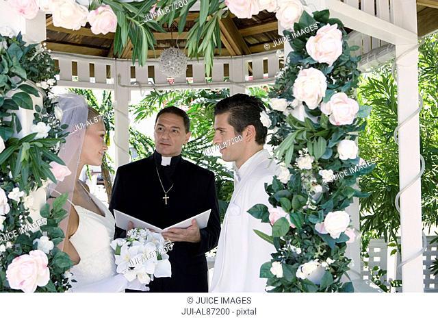Couple getting married in gazebo