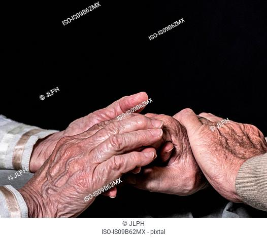 Hands of senior woman and man
