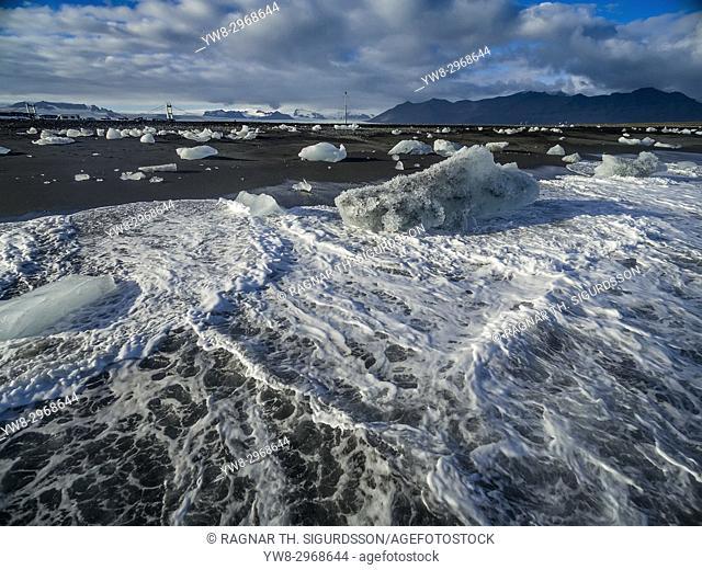 Ice formations on black sand beach. Ice comes from the Breidamerkurjokull Glacier, Vatnajokull Ice Cap, Iceland