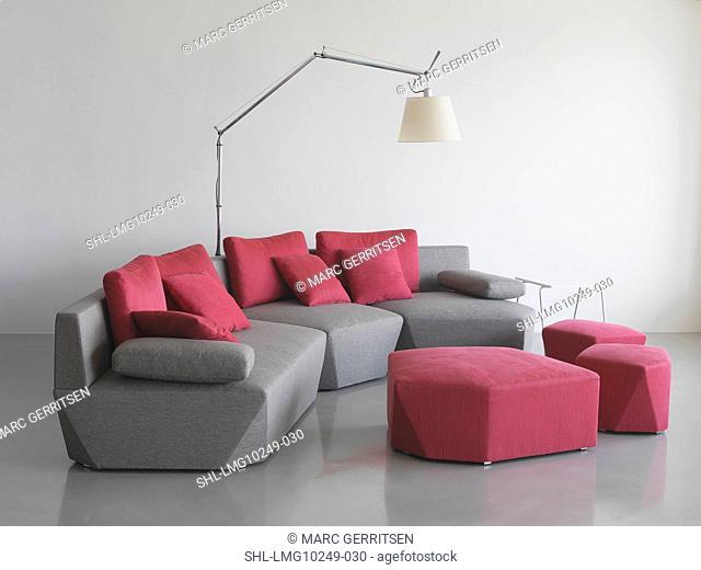 Modern gray sofa with pink throw pillows