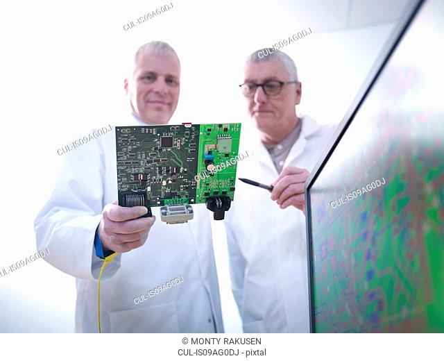 Engineers designing electronic circuitry for automotive use