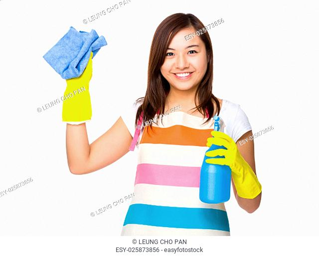 Housewife using rag and bottle spray