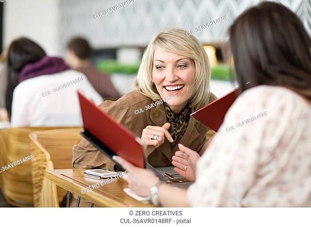 Businesswomen reading menus at lunch