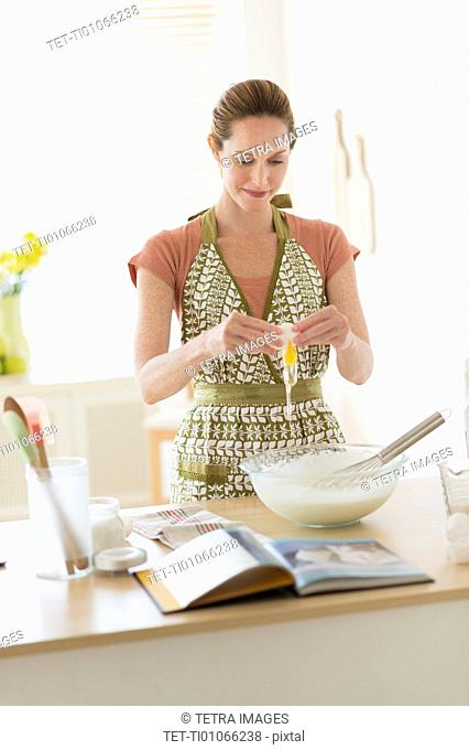 Woman cooking in kitchen