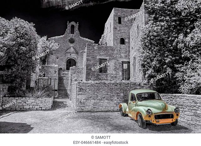 Village of Saignon with old car against church in the Luberon, Provence, France