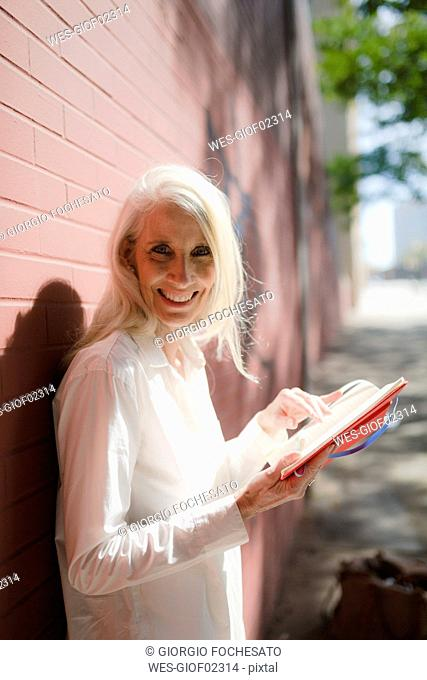 Portrait of smiling businesswoman with personal organizer