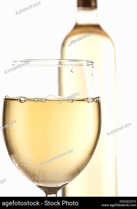 Wineglass and bottle with white wine isolated on white background