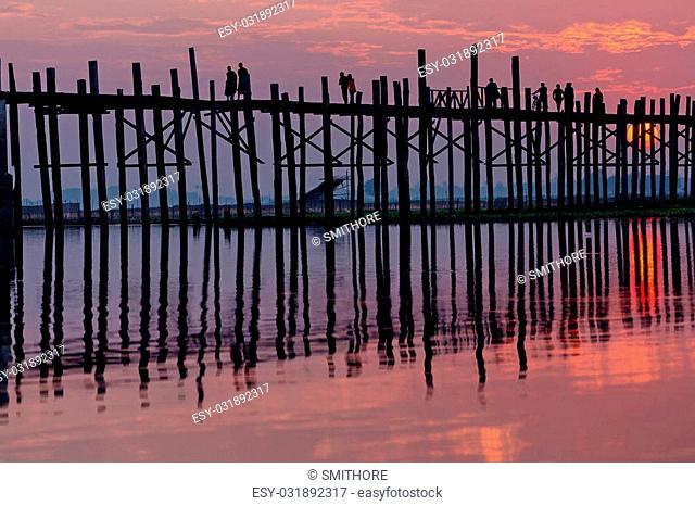 U bein wooden teck bridge under red sunset in Myanmar