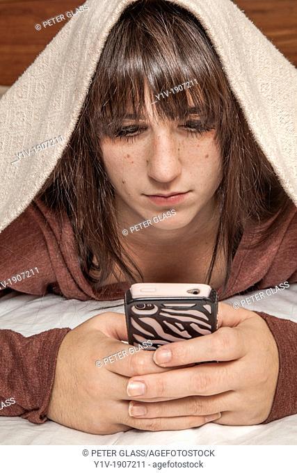 Teen girl with her smart phone