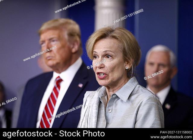 Dr. Deborah L. Birx, White House Coronavirus Response Coordinator, speaks as United States President Donald J. Trump, left