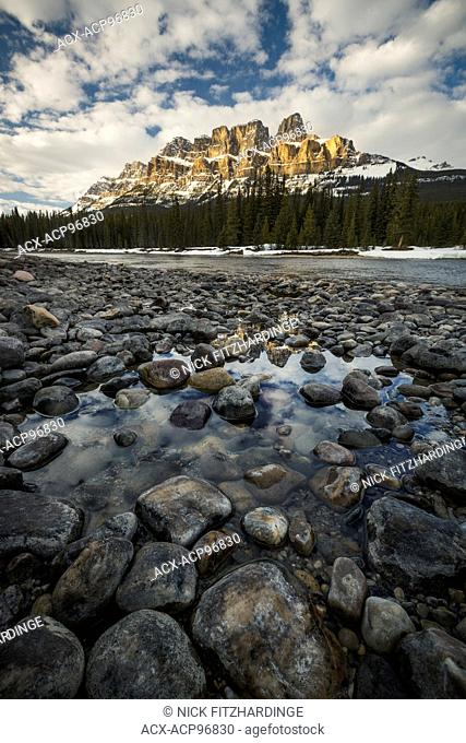 Light on Castle Mountain viewed from the Bow River bed near Castle Junction, Banff National Park, Alberta, Canada