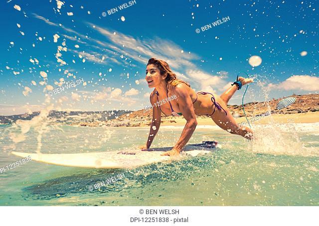 Woman having fun at the beach; Bolonia, Tarifa, Costa de la Luz, Andalusia, Spain
