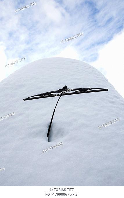 Snow mound covering parked car