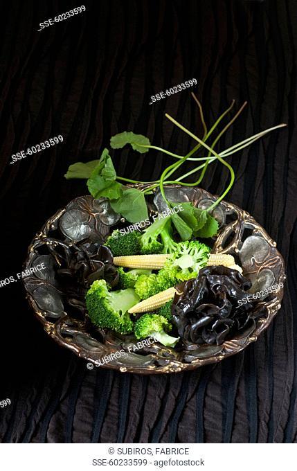 Broccolis,mini corn on the cobs and sauteed black mushrooms