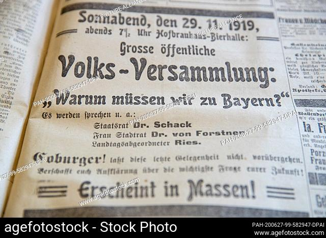 25 June 2020, Bavaria, Coburg: Advertisements for an assembly prior to the referendum of 30 November 1919 can be read in a historical daily newspaper in the...