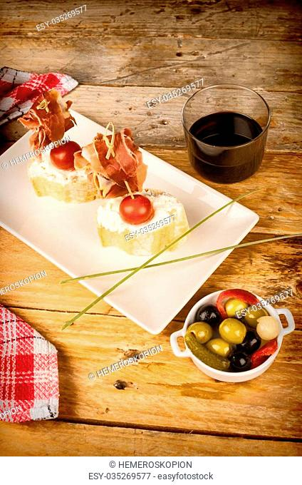 Ham pintxo served on bread with goat cheese